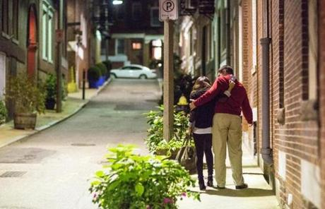 A couple walked together along Margaret Street at 2:30 a.m. in the North End. Both appeared to have difficulty standing and did not wish to be identified.